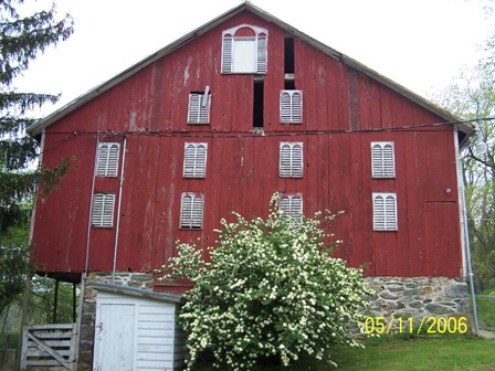 Side view of the barn at the front place in the Spring time